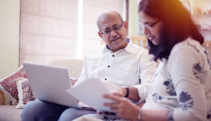 Indian couple browsing pre-paid funeral plans